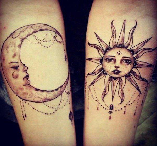 negru tatuaj de soare pe cot