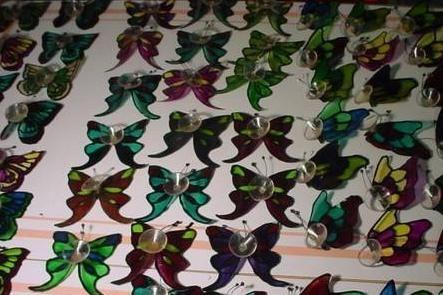 manual fluture dintr-o sticlă de plastic