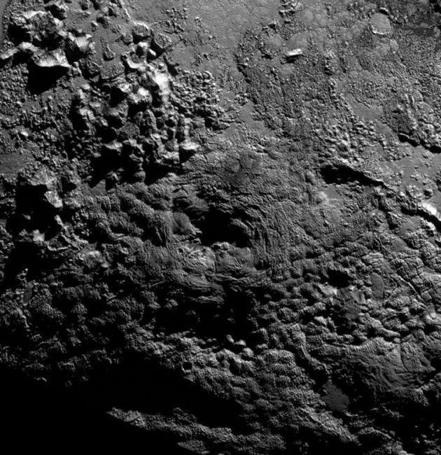 masa planetei Pluto